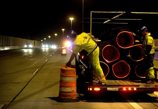 Wildlife resource employee participates in the scheduled release program of an adult traffic cone, or traffic barrier.