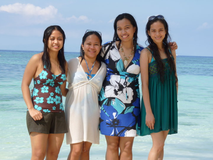Sisters get ready to teach families on the beach.